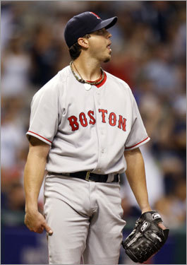 Josh Beckett gave up 8 runs in 4 1/3 innings as the Red Sox dropped Game 2, 9-8 in 11 innings. Here, the Sox righthander watched the flight of Cliff Floyd's home run in the fourth inning. The Floyd smash was one of three homers Beckett gave up in Game 2.