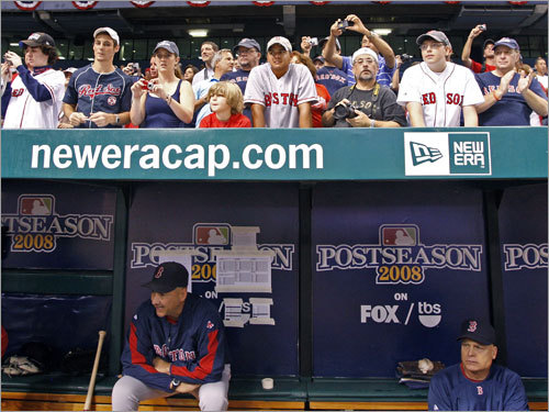 Red Sox manager Terry Francona (left) looked on from the dugout during warmups.