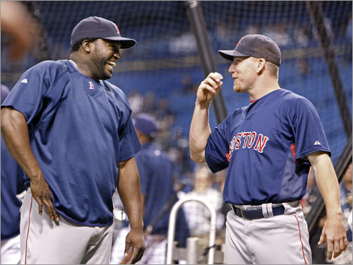 Red Sox DH David Ortiz (left) and right fielder J.D. Drew (right) shared a laugh during batting practice.