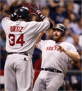 David Ortiz (34) and Kevin Youkilis reacted after scoring in the first.