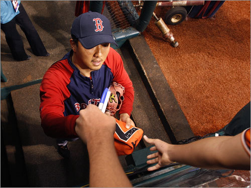 Red Sox reliever Hideki Okajima signed an autograph before the game.