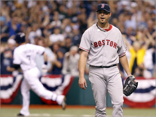 Red Sox starter Josh Beckett (right) reacted after giving up a two run home run off of the bat of Evan Longoria (left) in the first inning.