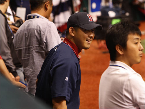 Game 1 winner Dice-K Matsuzaka peeked his head out of the dugout during warmups.