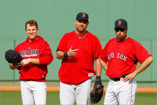 (Left to right): Jed Lowrie, Sean Casey, and Mark Kotsay stood on the field at Fenway.