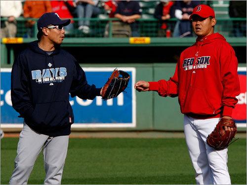 Rays second baseman Akinori Iwamura (left) and Red Sox pitcher Daisuke Matsuzaka talked on the field before the game.