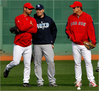 Red Sox pitchers Tim Wakefield (left) and Mike Timlin (right) talked with Rays reserve (and former Red Sox teammate) Eric Hinske (center) in the outfield.