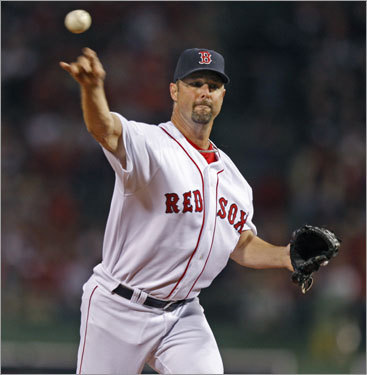 Red Sox Game 4 starter Tim Wakefield delivered a pitch in the first inning.