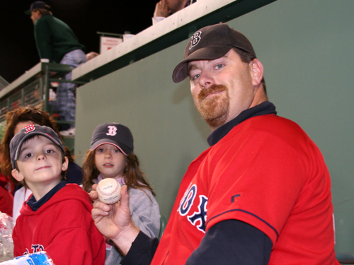 Up in the Monster seats, Kripps shows off the home run ball he caught barehanded on the fly.