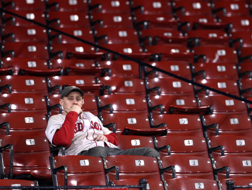 Steve Drake 26, of Needham sat dejected after the game. He hasn't washed his Red Sox jersey since he bought it in the 90's.