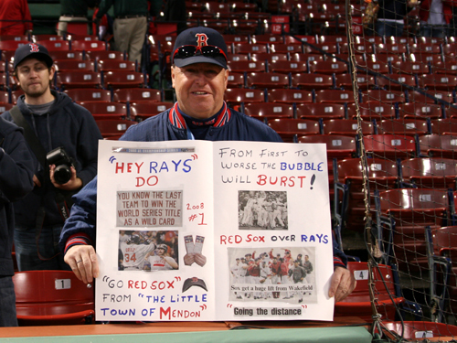 Phil Dunlavey, from the little town of Mendon, brought his trusty sign montage to Game 4. 'They're gonna do it tonight,' Dunlavey said positively about the Red Sox before the game.