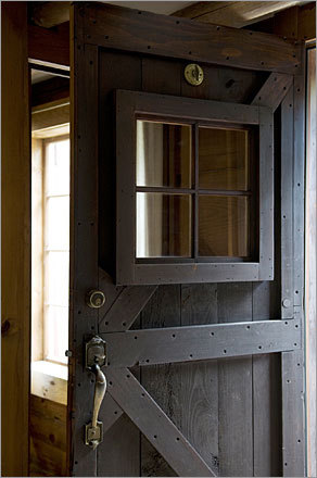Barn style front door in house