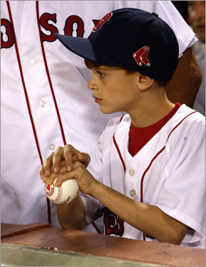 A young Red Sox fan watched batting practice before the game.