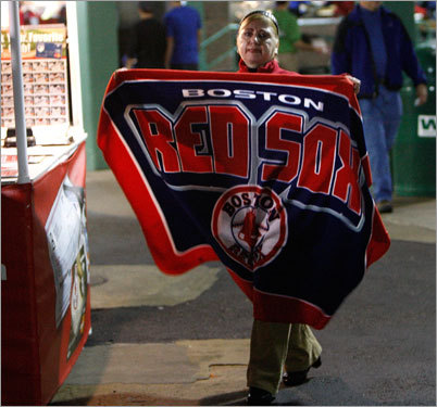 A vendor held up a Red Sox blanket on Yawkey Way prior to Game 5.
