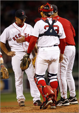 After allowing a walk in the fifth inning, Dice-K (left) was pulled from the game by Red Sox manager Terry Francona (right).