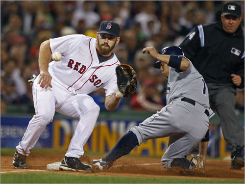 Kevin Youkilis (left) waited for the ball was Rays second baseman Akinori Iwamura was safe at third with a stolen base in the fifth inning.