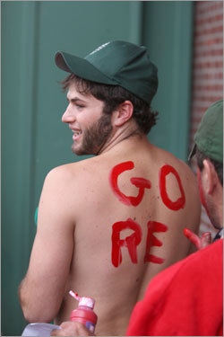 Dan Six of Newton, N.H. got his back lettered with as he waited in line for tickets on Landsdowne Street.