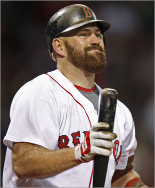 Red Sox third baseman Kevin Youkilis reacted after striking out.