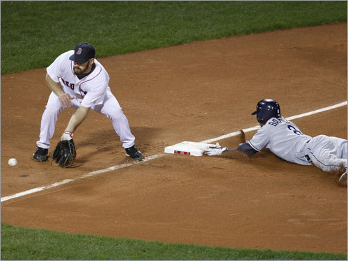 Rays shortstop Jason Bartlett slid into third base on a double steal in the seventh inning.