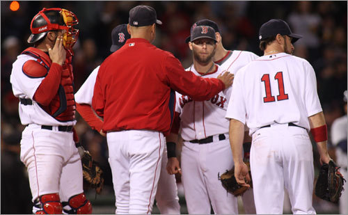 Red Sox manager Terry Francona (center) met with the infielders during a pitching change in the seventh inning.