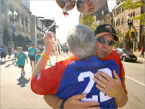Worcester Tornadoes manager and former Red Sox catcher Rich Gedman hugs Greg Montalbano's mother, Sharon, at the end of the Walk. 'He's a very special kid, courageous,' says Gedman. 'He doesn't want to be the kid that had cancer and survived it. He wants to be a normal guy.'