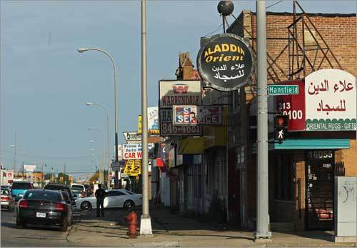 The Arab population of Dearborn, Mich., makes up about 35 percent of the 100,000 residents -- the highest concentration of any US city. Warren Avenue in Dearborn has many Arab-American merchants. Signs in both Arabic and English dot the avenue.