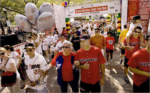 Team Montalbano crosses the finish line at the Jimmy Fund Walk in Copley Square in 2006. Montalbano was too ill to take part in the walk, but his parents, Andrew and Sharon, walked arm in arm with former Northeastern catcher Patrick Mason (center).