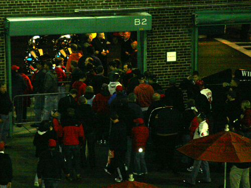 In the bottom of the sixth inning, with the score 5-0 Rays, quite a few fans make their way to the exit gates at Fenway.