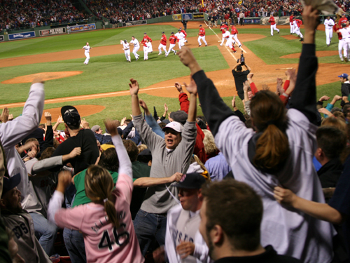 Fans go wild at Fenway when J.D. Drew drives in Kevin Youkilis for the 8-7 win that sends the series back to Tampa for Game 6 Saturday night.
