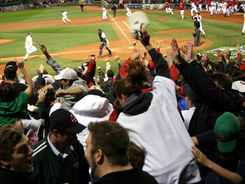 Kevin Youkilis charges home with the winning run as the fans who stayed the distance were rewarded with one of the greatest comeback wins in Red Sox history.