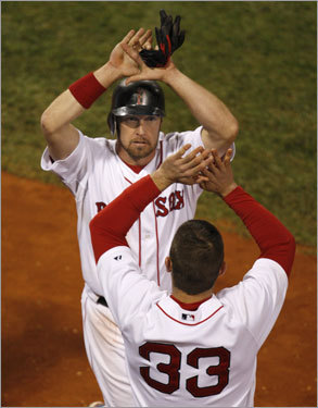 Kotsay celebrated with Jason Varitek (33) after crossing the plate.