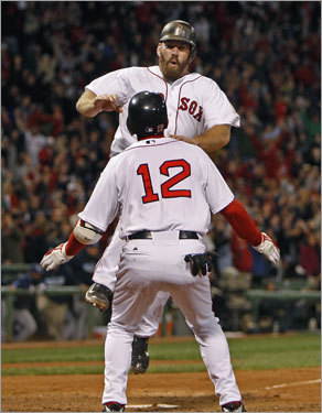 Youkilis and Lowrie celebrated the Red Sox' improbable 8-7 victory in Game 5 of the ALCS.