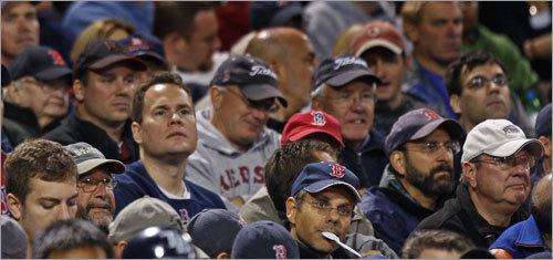 The long faces on these Red Sox fans tell the story as the Rays build a big early lead.
