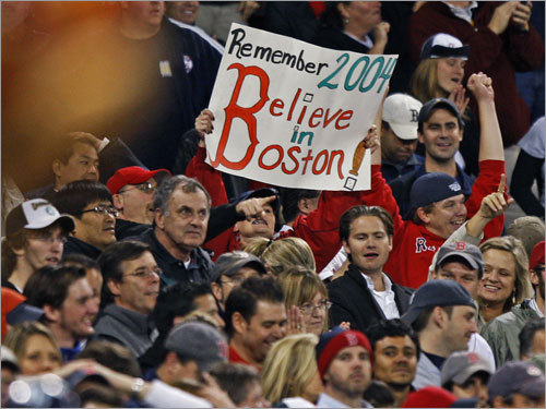 A sign in the stands is prophetic as the Sox claw their way back en route to victory.