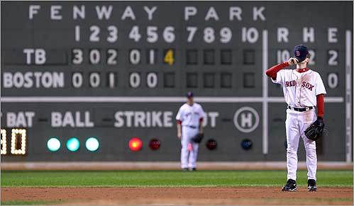 Red Sox shortstop Jed Lowrie covered his face during the sixth inning of Game 4 of the American League Championship Series against the Tampa Bay Rays on Oct. 14. The Rays won 14-3.