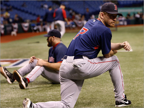 Red Sox right fielder J.D. Drew (right) stretched out on the field prior to Game 6.