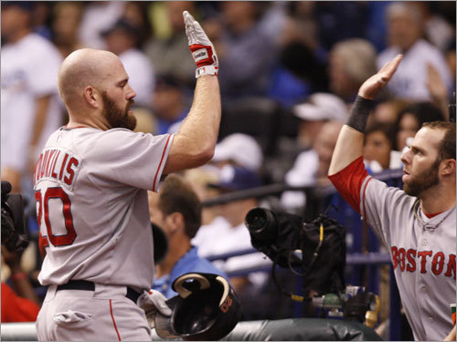 Red Sox second baseman Dustin Pedroia (right) congratulated Kevin Youkilis (left) after Youk's home run.