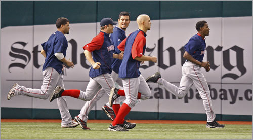 Red Sox players warmed up in the outfield before Game 6.