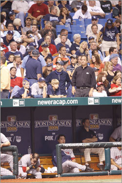 Fans milled about during an umpire change in the third inning.