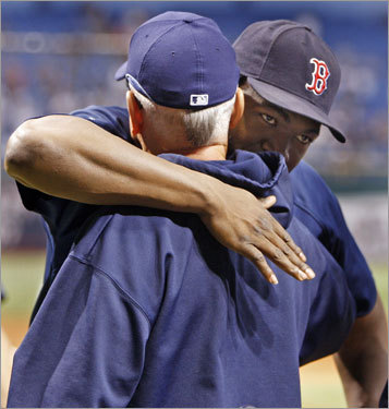 Red Sox DH David Ortiz gave Rays manager Joe Maddon a hug before Game 7.