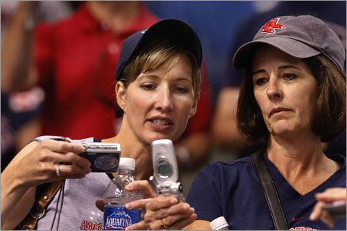 Sox fans at the Trop compared cell phone photos.