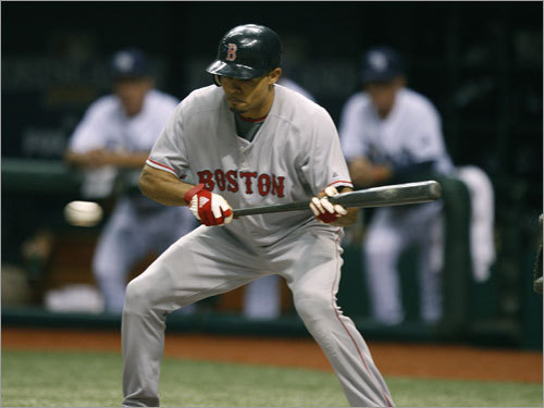 Red Sox center fielder Coco Crisp led off the game with a bunt, but was thrown out at first.