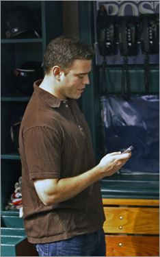 Cell phone in hand, general manager Theo Epstein strolled through the Red Sox dugout before Game 7.