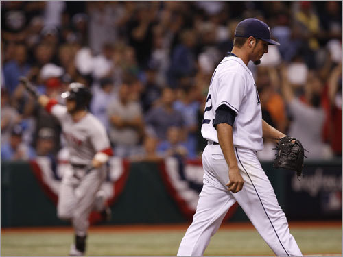 Rays starter Matt Garza (right) reacted after giving up a solo home run to Dustin Pedroia (left) in the first inning.