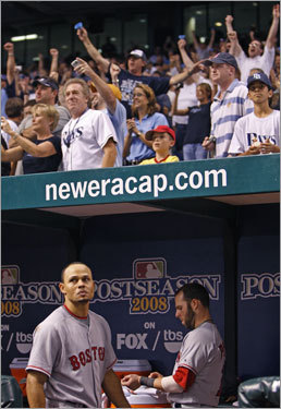 Red Sox players Coco Crisp (left) and Dustin Pedroia (right) reacted to losing Game 7 of the ALCS.
