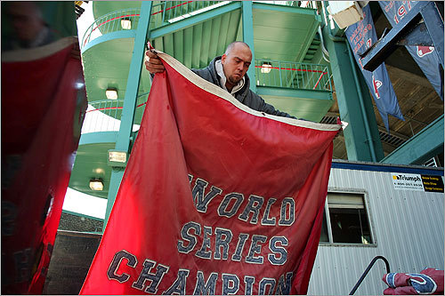 A tough loss for the Red Sox in the American League Championship Series ended the season, both for the team, and the groundskeepers who maintain Fenway Park. This week, as the reality of the season's end sank in, the grounds crew went to work putting Fenway to bed until next year. At left, Joe Gravell folded a World Series banner that was taken down. The banners hang in the concession area in right field and are put in storage for the winter.