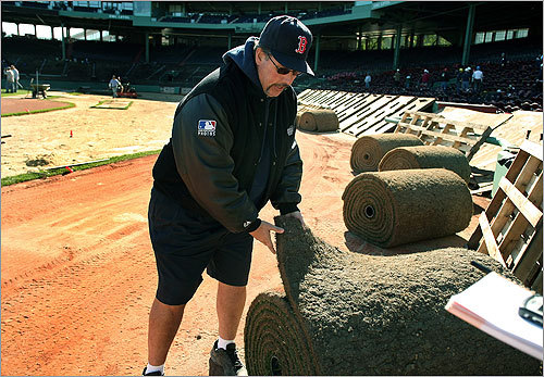 Red Sox grounds director David Mellor supervised the replacement of 20,000 square feet of sod.