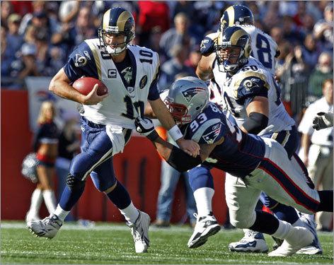 Patriots defensive lineman Richard Seymour sacked Rams quarterback Marc Bulger.