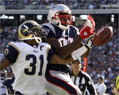 Rams cornerback Jason Craft (31) broke up a touchdown pass intended for wide receiver Randy Moss during the second quarter.