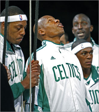 Celtics players Paul Pierce (left), Ray Allen (center), Kevin Garnett (right) and Rajon Rondo looked on during the banner raising ceremony.