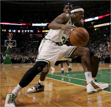 Celtics forward Paul Pierce drove to the basket against Cavs forward Lebron James in the season opener.
